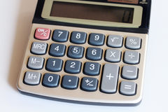 Keypad calculator with computing. Is on the table Stock Images