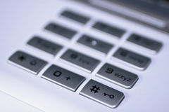 Keypad with hash key. Key pad of a modern office phone with focus on hash key royalty free stock images