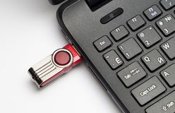 Keypad of a notebook and usb drive Royalty Free Stock Images