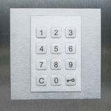 Keypad, numbers and key smbol - door security system. Keypad, numbers and key symbol on numeric keyboard Stock Photography
