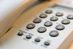 The keypad of the phone. In the office Royalty Free Stock Photography