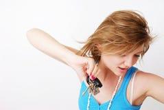 Keys. Female model holding up a set of keys looking towards the ground Stock Photos