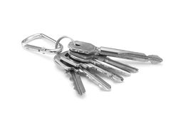 Keys. Bunch of keys and charm on a white background Stock Image