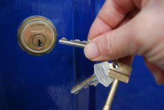Keys. Hand holding the keys near to door lock Royalty Free Stock Photo
