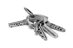 Keys. Some keys in a keyring isolated on a white background royalty free stock photo