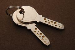 Keys. Silver keys in dark background Stock Photos