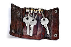 Keys. Some keys in a leather keychain isolated on a white background royalty free stock photos