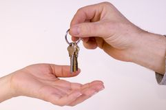 Keys. Person is giving keys to someone else Stock Photos