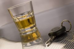 Keys. Car keys with glass of whiskey in background - drink drive concept Stock Photo