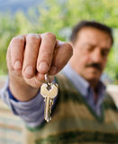 Keys. Man who holds the keys Royalty Free Stock Image