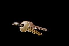 Keys. House keys isolated against black background Stock Image