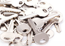 Keys. A pile of keys on white background stock photos