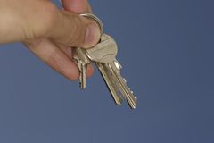 Keys. Hand holding keys Royalty Free Stock Photo