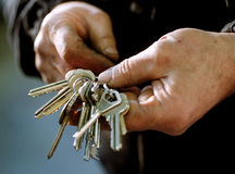 Keys. A man holding a large bunch of keys with different keys Royalty Free Stock Photography