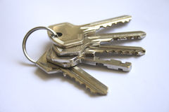 Keys. Bunch of keys on a white paper as background Royalty Free Stock Image