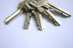 Keys. Bunch of keys on a white paper as background Royalty Free Stock Photo