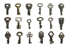 Keys. A dozen and a half of mail-box and other small keys on white Royalty Free Stock Images