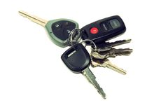 Keys. Bunch of house and car keys with remote isolated on white background Stock Photo