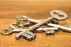 Keys. Antique door keys on a wooden surface stock image