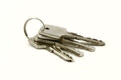 Keys. Four keys isolated over white Royalty Free Stock Photos