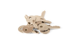 Keys. Eight keys are photographed on a white background Royalty Free Stock Photography