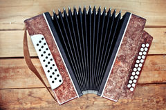 Keys accordion. On the wood background stock images