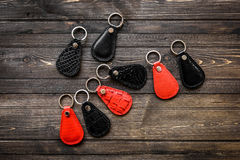 Keys attached to leather keychain , on wooden background Stock Photo