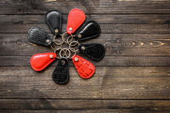 Keys attached to leather keychain , on wooden background Royalty Free Stock Photography