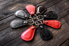 Keys attached to leather keychain , on wooden background Stock Images