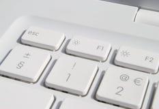 keys bärbar dator fotografering för bildbyråer