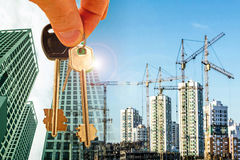 The keys on the background of the construction of new modern buildings . Royalty Free Stock Photography