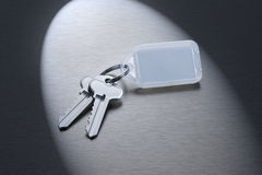 Keys on a Blank Keyring. A set of keys on a keyring with a blank plastic fob for writing on Royalty Free Stock Photography