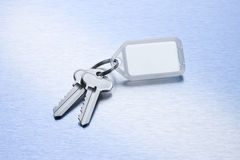 Keys on a Blank Keyring. A set of keys on a keyring with a blank plastic fob for writing on Royalty Free Stock Photos