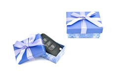 Keys and blue gift boxes Royalty Free Stock Photos