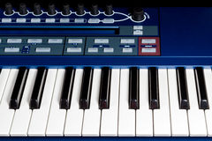 Keys blue piano synthesizer. Fragment blue electric music synthesizer with a set of buttons Stock Photo