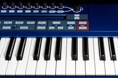 Keys blue piano synthesizer Stock Photo