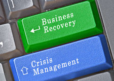 Keys for business recovery and crisis management. Keyboard with Keys for business recovery and crisis management Royalty Free Stock Photos