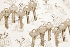 Keys and Calendar Pages Stock Photography