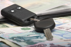 Keys from the car. Keys and documents from the car against from monetary denominations Stock Images
