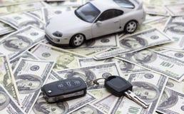 Buying a car, loan, loan, savings. Keys from car on banknotes. Buying a car, loan, loan, savings. Auto business stock image