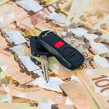 Keys from car on banknotes Stock Photos