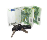 Keys from the car and a money Royalty Free Stock Photos