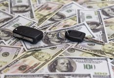 Keys from car on money dollar banknotes stock photos