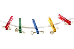 Keys on a clothesline. Clothespins with a silver and gold keys made of plexiglas hanging on a clothesline Stock Images