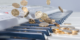 Keys and coins falling Stock Photography