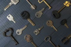 Keys collection on wooden table stock images