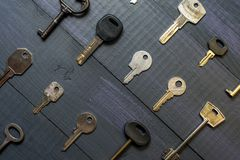 Many different keys on wooden background royalty free stock photos