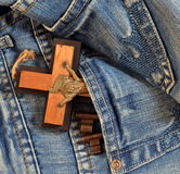 Keys, cross in jeans pocket Royalty Free Stock Photography