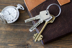 The keys at the diary and watch a top view Stock Image