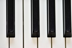 Keys of a digital piano, soft focusing, creative mood of a person improvisation and creativity. Midi piano keyboard for playing digital music and making stock image